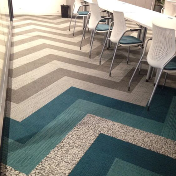 Mixture of grey and turquoise carpet planks