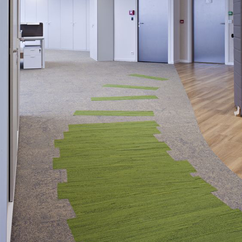 Pathway created using green carpet planks