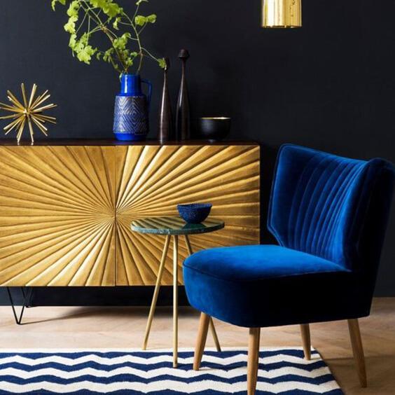Dark blue interior with metallic gold accents
