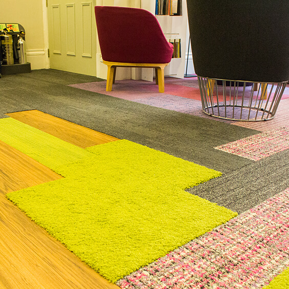 Mixture of LVT and carpet planks