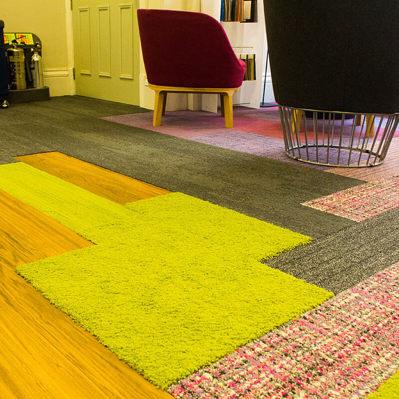 Interface office floor combining LVT, planks and different pile heights and textures