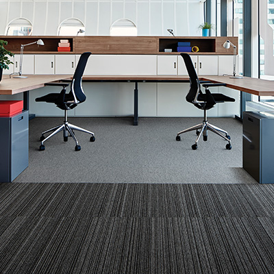 Interface Output Lines carpet tiles with castor chairs on top