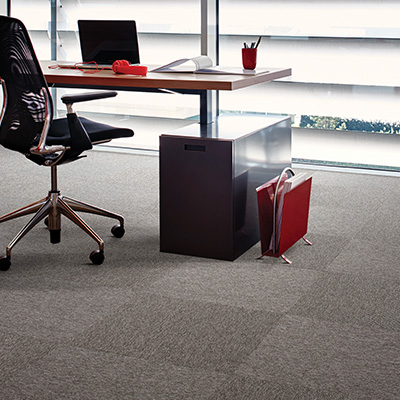 Interface Output Micro carpet tiles in an office with desk and chair