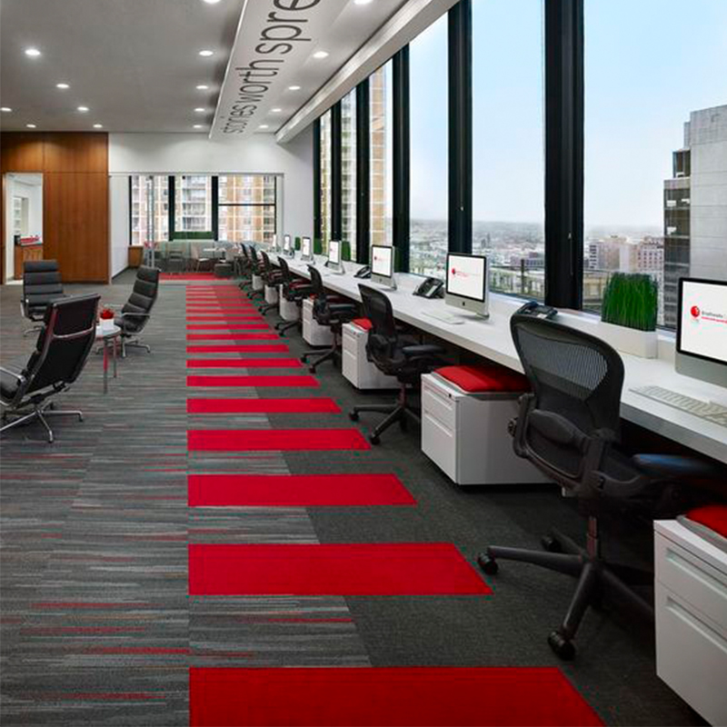 Commercial space contrasting grey tiles with red blocking