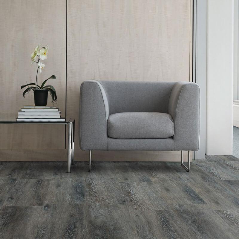 Grey/brown textured woodgrain used in seating area